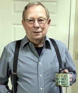 alcon holding tin cup fro hanoi hilton