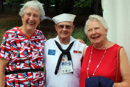 Older veteran with ladies celebrating 4th of july