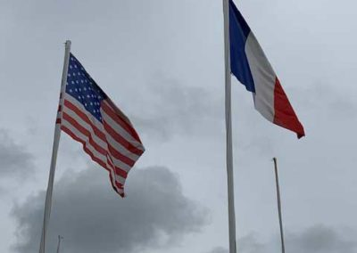 American and French flags on Omaha Beach