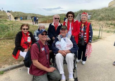 Sarros and Bugala, Omaha Beach with ladies and gifts