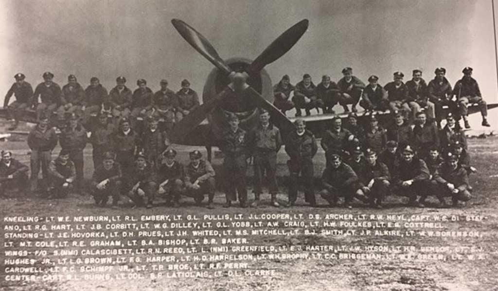 WWII pilots in front of old airplane